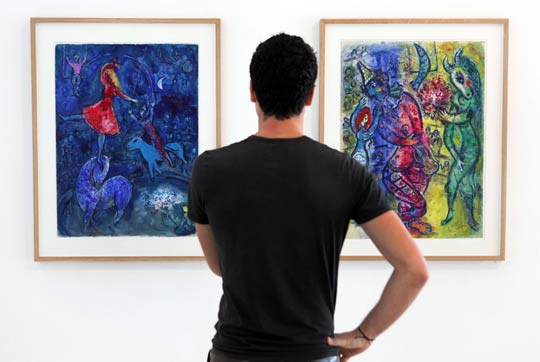 A man visits an exhibition showing paintings by French artist Marc Chagall at the Marc Chagall museum in Nice, southeastern France. AFP PHOTO/SEBASTIEN NOGIER